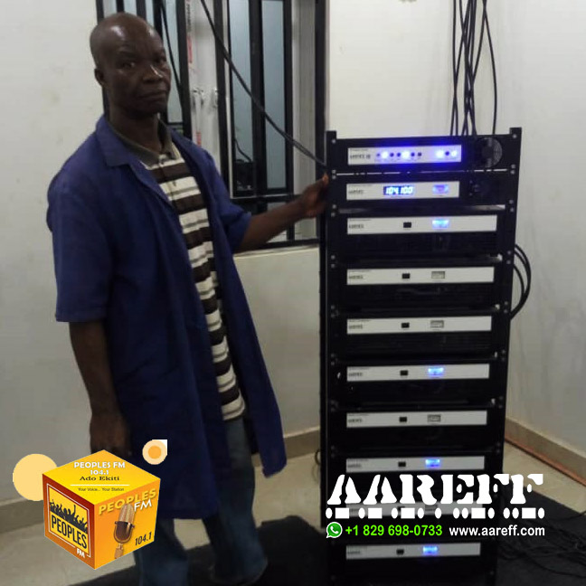 The engineer of Peoples FM standing proud in front of the new Aareff Transmission System